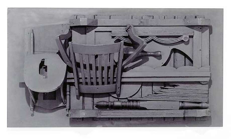 """""""Untitled""""  by Louise Nevelson, 1976-78  black painted wood relief sculpture  44 h x 80 w x 16"""" d"""