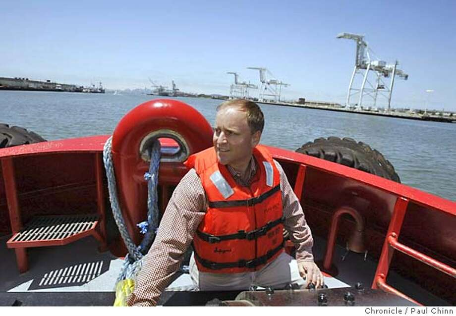 Tom Crowley admires the view of the estuary from the bow of the Tioga, one of two tugs his company operates on SF Bay. Cruising on the Oakland Estuary aboard Crowley Maritime's Tioga tugboat in Oakland on 6/18/04. PAUL CHINN/The Chronicle Photo: PAUL CHINN