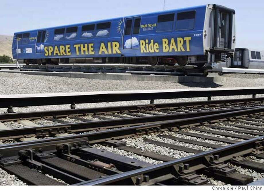 """BART officials unveil rail cars wrapped with advertisements from the """"Spare the Air"""" campaign at the transit agency's maintenance facility in Hayward on 6/16/04. BART will offer free rides on select morning commute runs during the summer. PAUL CHINN/The Chronicle Photo: PAUL CHINN"""