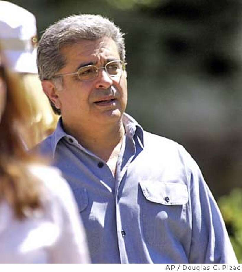 Yahoo! Inc.'s CEO Terry Semel breaks for lunch at the annual Allen & Co. media conference Thursday, July 10, 2003, in Sun Valley, Idaho. Semel announced Monday, July 14 that his company is buying Overture Services Inc., which pioneered a pay-for-placement search engine, in a $1.6 billion deal. (AP Photo/Douglas C. Pizac) Photo: DOUGLAS C. PIZAC