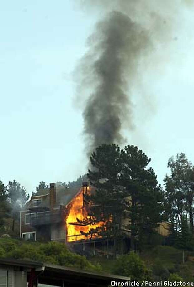 Thirty Mill Valley firefighters spent more than three hours Tuesday battling a fire that caused $1.2 million in damage to a Milland Way townhouse building. Chronicle photo by Penni Gladstone