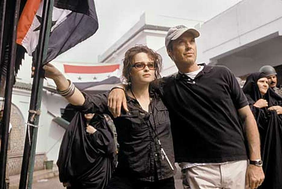 THIS IS A HANDOUT IMAGE. PLEASE VERIFY RIGHTS. LIVE FROM BAGHDAD: Helena Bonham Carter, Michael Keaton. photo: Andrew Cooper Photo: HANDOUT