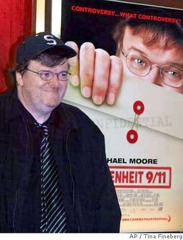 "Michael Moore poses for photographers during a special screening of his new film ""Fahrenheit 9/11"" Monday June 14, 2004 in New York. (AP Photo/Tina Fineberg) Photo: TINA FINEBERG"