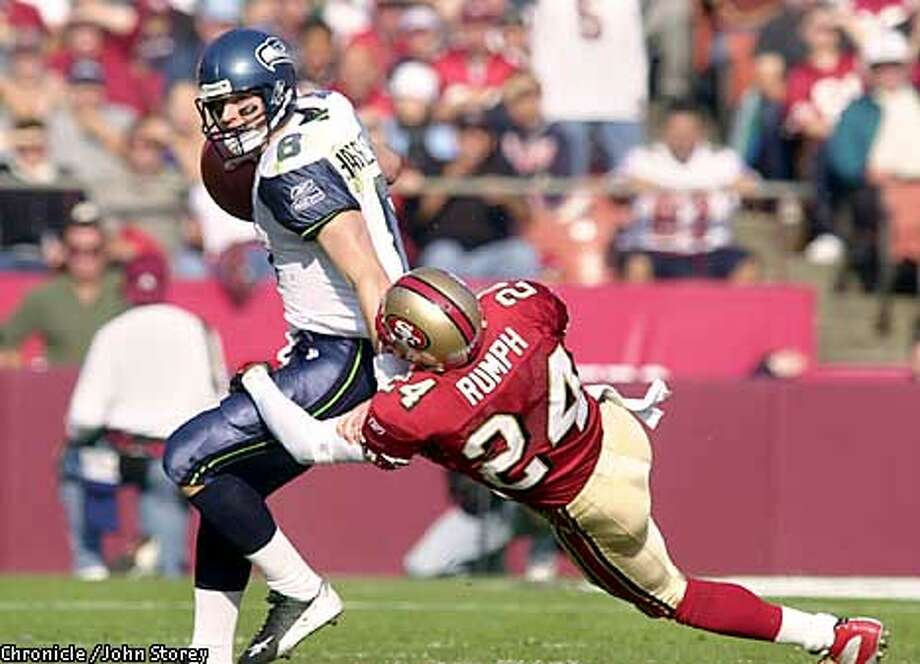 49ERS-C-01-DEC02-SP-JRS-The 49ers vs. the Seahawks at Candlestick Park. Mike Rumph of the 49ers can't quite sack Matt Hasselbeck of the Seahawks.Chronicle photo by John Storey.