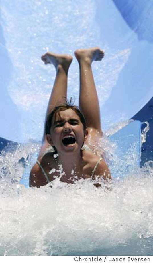 EBLPARKS_009_LI.JPG event on 6/10/04 in PLEASANTON Gianna Smith age 10 from Danville takes a header into the splash pool at Pleasanton's Shadow Cliffs Regional Park. By Lance Iversen/The San Francisco Chronicle Photo: Lance Iversen