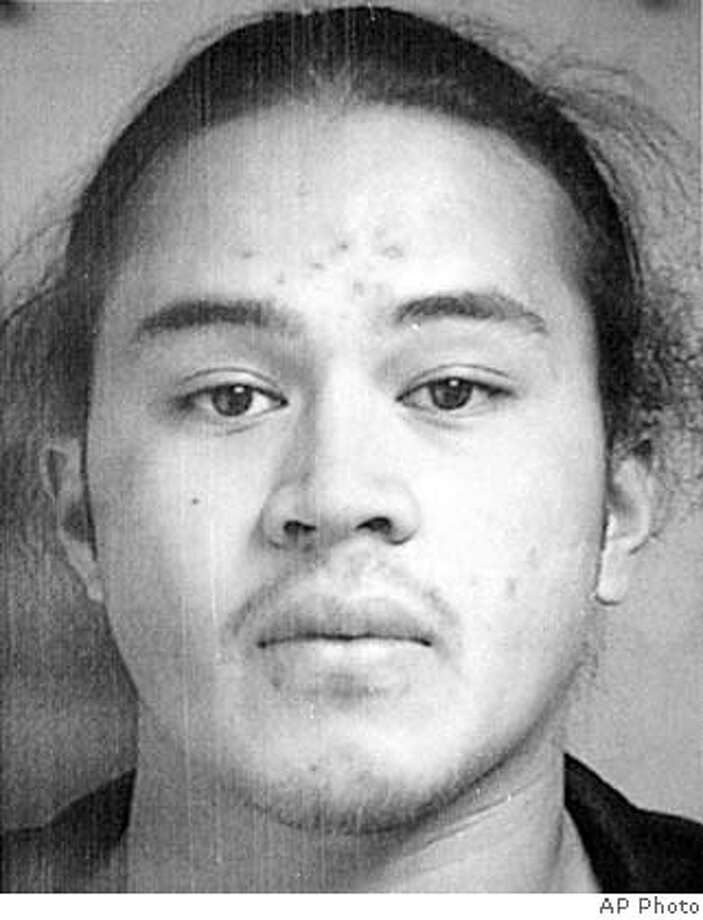 Bank robbery and murder suspect Seti Scanlan, of Mountain View, Calif., shown in this undated photo released by the police Sunday, Nov. 3, 2002, is considered armed and dangerous by authorities. Burlingame, Calif. police believe Scanlan, 24, is responsible for the death of Wells Fargo Bank manager Alice Martel, who was shot during an Oct. 11 robbery. (AP Photo/Police photo via San Mateo Times). ALSO RAN 11/9/02 CAT UNDATED PHOTO BLACK AND WHITE ONLY