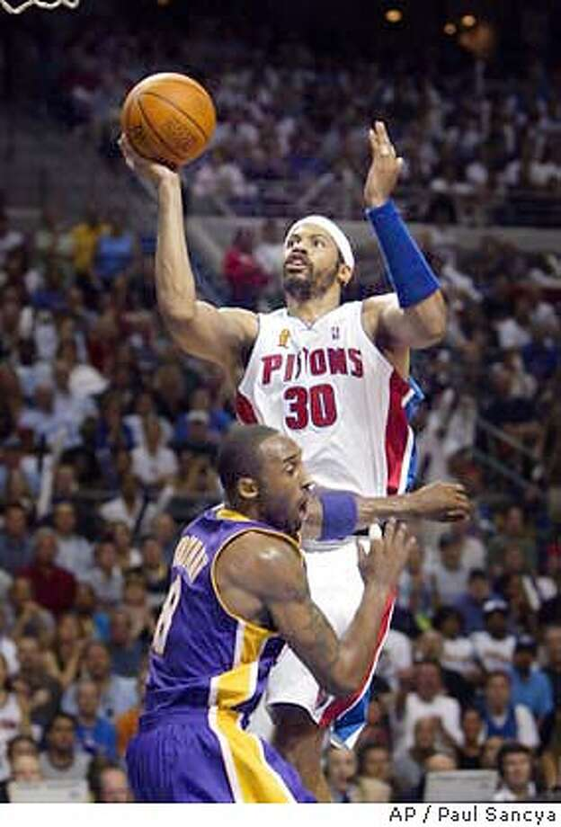 Detroit Pistons Rasheed Wallace (30) goes to the basket over Los Angeles Lakers Kobe Bryant (8) in early second half action of Game 4 of the in Auburn Hills, Mich. Sunday night June 13, 2004. (AP Photo/Paul Sancya) Photo: PAUL SANCYA