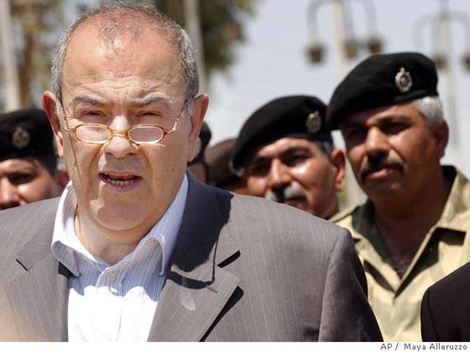 Iraqi Interim Prime Minister Iyad Allawi makes remarks outside the Muntheria border crossing at the Iran-Iraq border Sunday June 13, 2004 on his first trip outside Baghdad since being tapped to lead Iraq once sovreignty is turned over. ( Maya Alleruzzo, POOL / The Washington Times ) Photo: MAYA ALLERUZZO