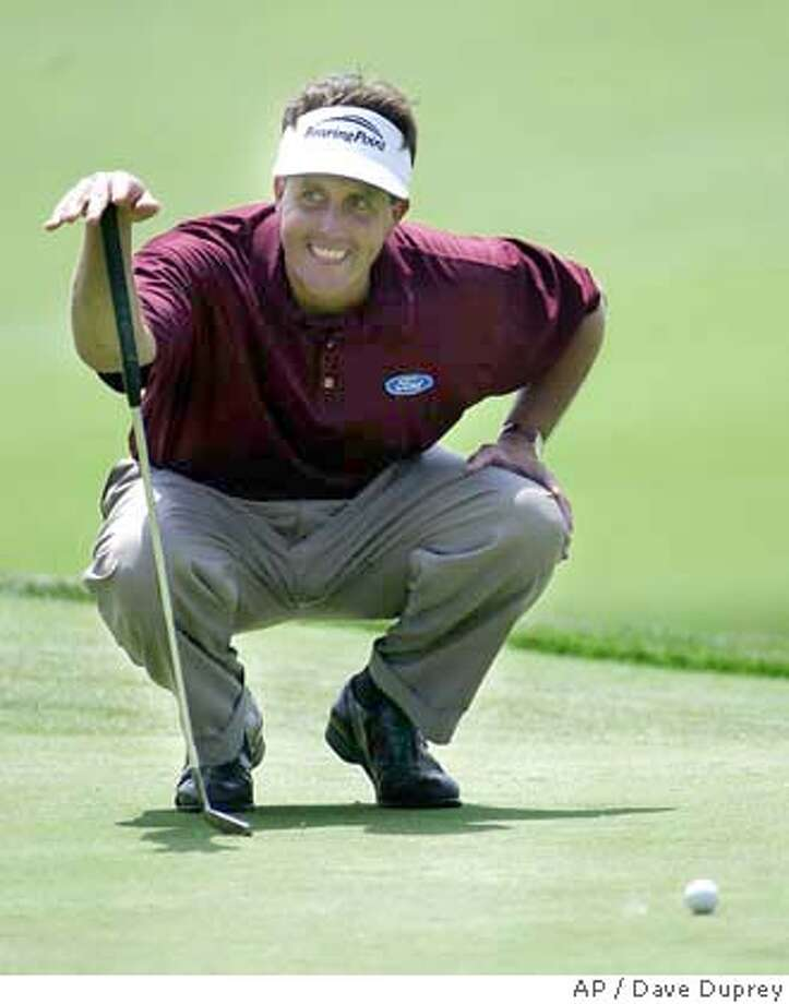 Phil Mickelson, who won the Masters, lines up a practice putt at Shinnecock Hills. Associated Press photo by Dave Duprey