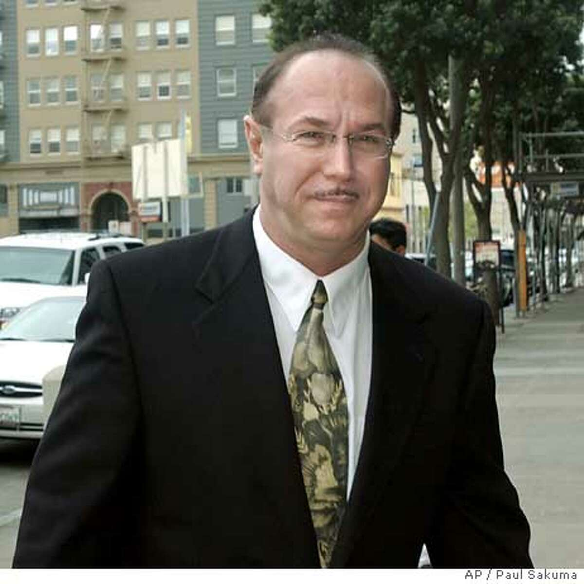 ** FILE ** Victor Conte, San Francisco Giants Barry Bonds' nutritional adviser and founder of the Bay Area Laboratory Co-Operative (BALCO) arrives at the Federal Courthouse in San Francisco, in this March 26, 2004 photo. The lack of a plea agreement between prosecutors and Conte, accused of distributing steroids to top athletes may make it more difficult for anti-doping authorities to build drug cases against track stars. Conte, founder of the Bay Area Laboratory Co-Operative, and his attorneys met with federal authorities for about three hours Thursday, June 4, 2004, in San Jose, Calif., but did not reach any deal. (AP Photo/Paul Sakuma)