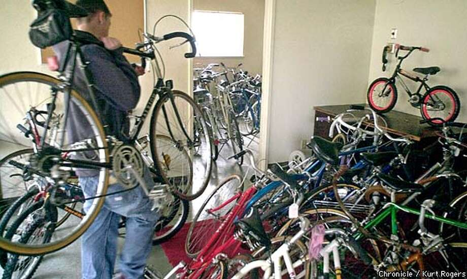 Volunteer Don Inic, 14, of San Carlos adds another bike to the collection of bicycles that will be given out for Christmas by Samaritan House. Chronicle photo by Kurt Rogers