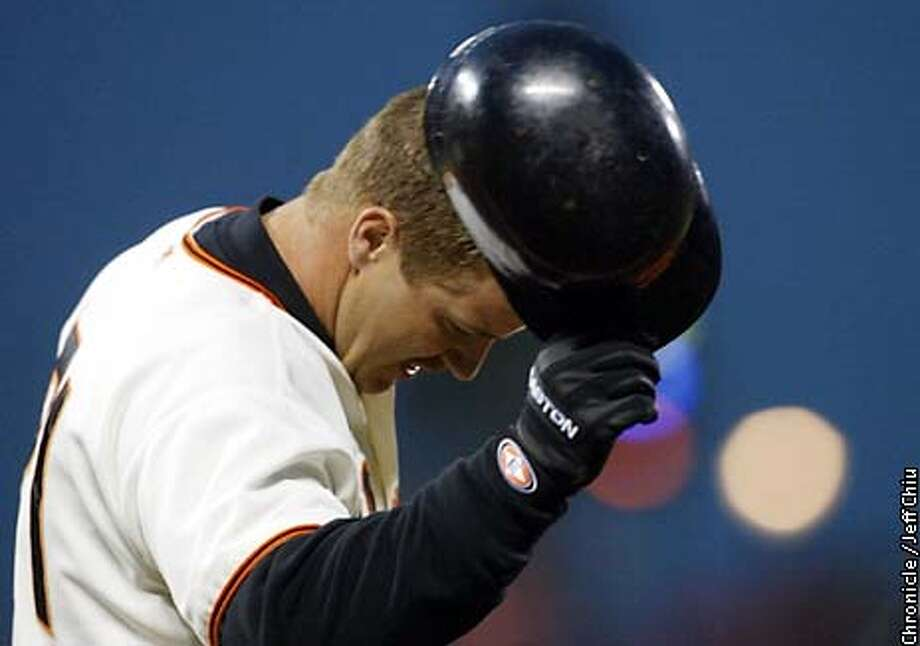GIANTS22B-C-21JUN02-SP-JC-- Jeff Kent is upset after hitting into a inning ending play for the second time in his first two at-bats in the third inning as the Giants host the Baltimore Orioles on Friday night.  Photo by Jeff Chiu/The Chronicle