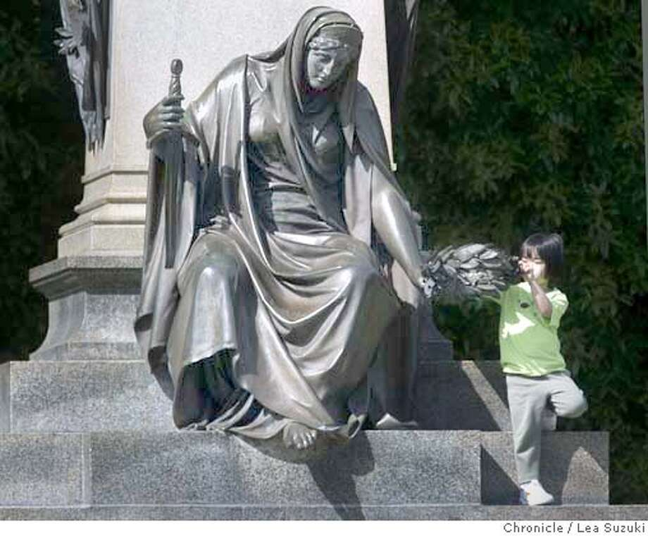 Abby Yang, 4, of Seattle gets a helping hand as she climbs a statue in Golden Gate Park. Yang was visiting Golden Gate Park with her family on vacation from Seattle. Photo taken on 6/14/04 in San Francisco, CA.  Lea Suzuki/ San Francisco Chronicle Photo: Lea Suzuki