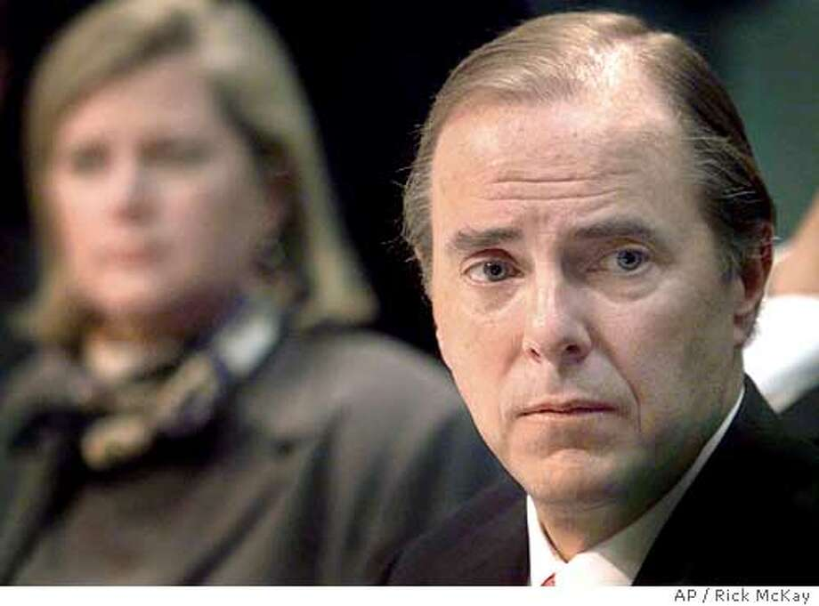 (NYT20) WASHINGTON -- Feb. 26, 2002 -- ENRON-SKILLING-2-COX -- Jeffrey Skilling, the former CEO of Enron, right, during his testimony before the Senate Commerce Committee, in February, 2002. At left, Sherron Watkins, Enron's vice president who said before another committee that Skilling had manipulated Enron's former chairman. Federal prosecutors are planning to seek a criminal indictment against Jeffrey Skilling, a former chief executive of Enron, people involved in the case said Thursday, Feb. 12, 2004. (Rick McKay/Cox News Service) Jeffrey Skilling Ran on: 06-15-2004  ProductNameChronicle Ran on: 06-15-2004  ProductNameChronicle Photo: RICK MCKAY