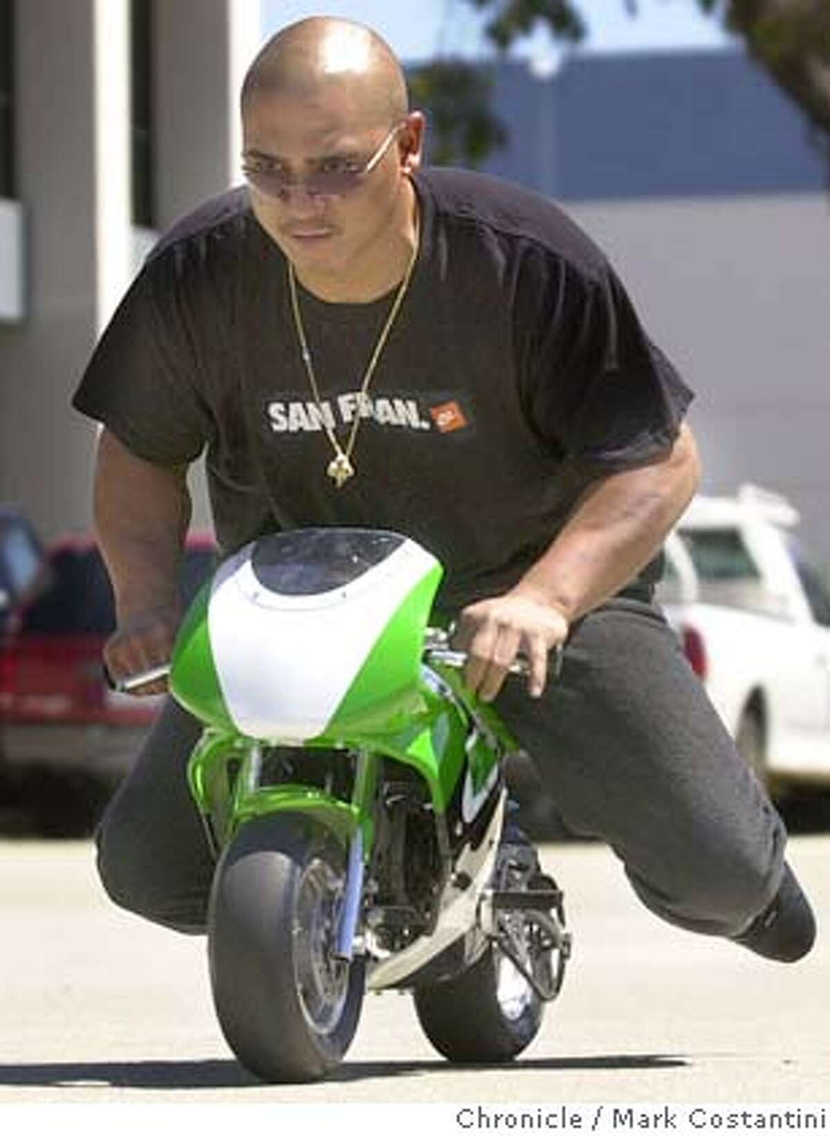 BIKES16_057.JPG Photo taken on 6/16/04 in SOUTH SAN FRANCISCO. Ervin Nicolas rides a pocket bike, a new type Are of minature motorcycle that is becoming popular with Bay Area youths. Photo: Mark Costantini/SF Chronicle