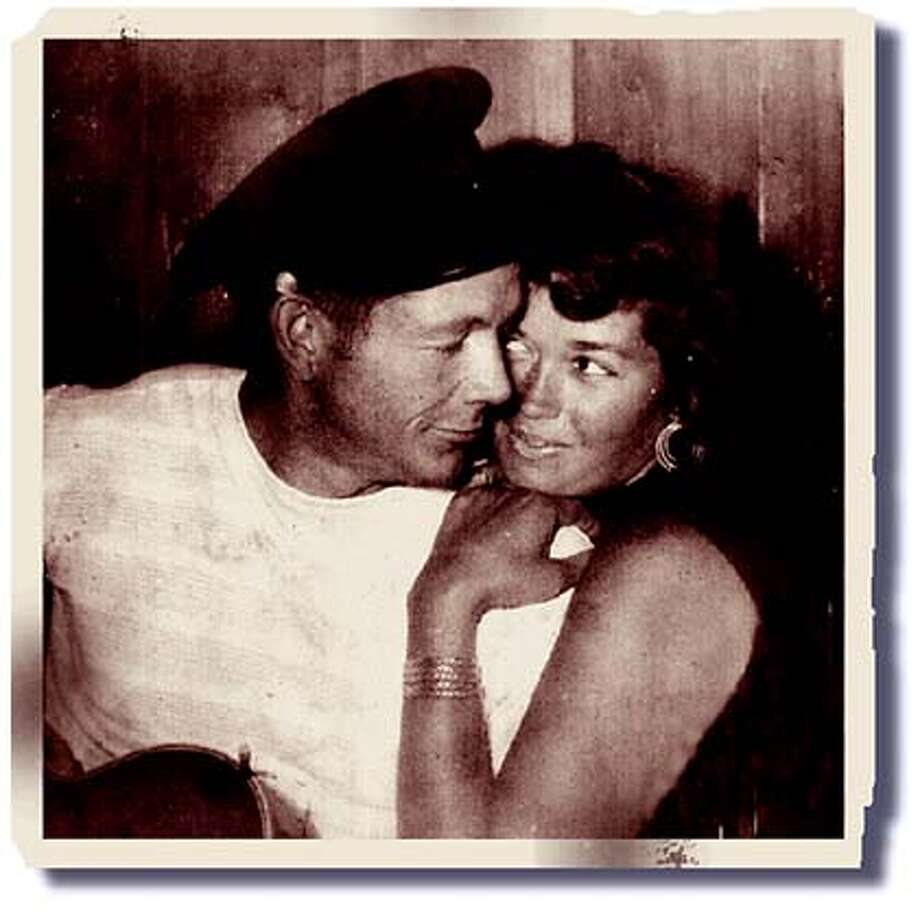 The author's parents share a tender moment after dinner at home in Lagunitas, circa 1960. Photo courtesy of Adair Lara