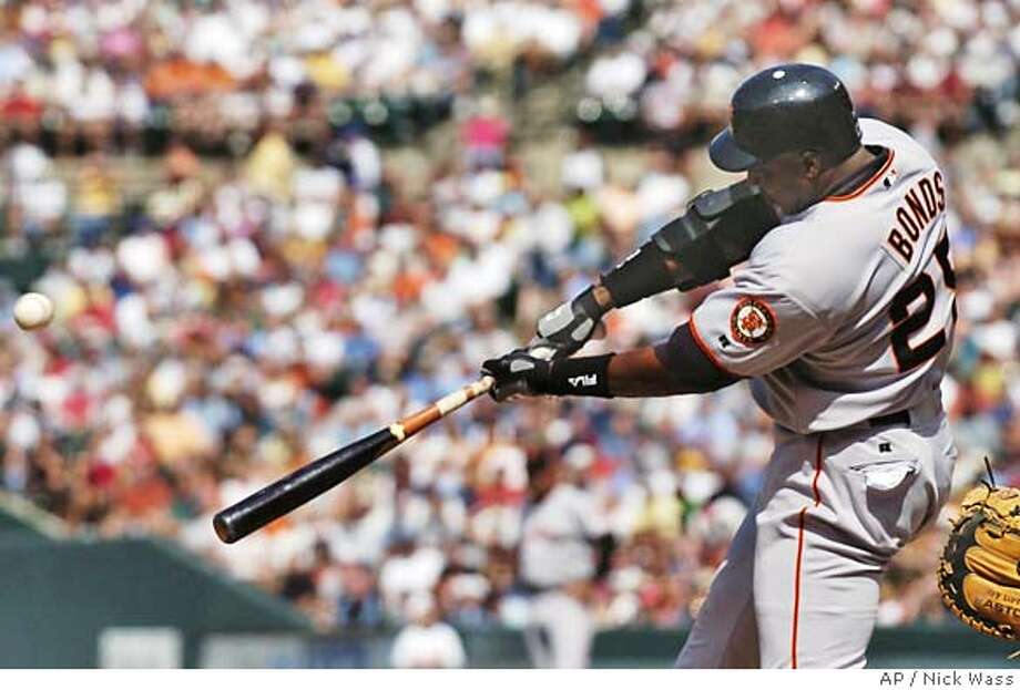 San Francisco Giants' Barry Bonds connects for a solo homerun off Baltimore Orioles pitcher Rodrigo Lopez in the third inning Saturday, June 12, 2004 at Camden Yards in Baltimore.(AP Photo/Nick Wass) Photo: NICK WASS