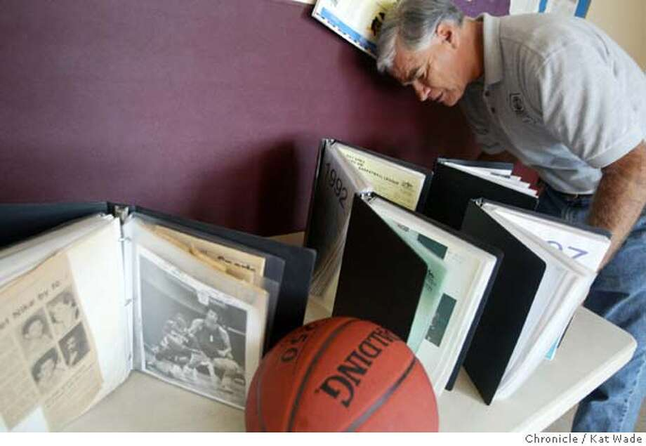 GREENBERG_0015_KW.jpg  Jon Greenberg, founder of the 25-year-old San Francisco Bay Area ProCity basketball league and director of Potrero Hill Recreation Center for 38 years, poses with his collection of news clippings and photographs at the recreation center Thursday in San Francisco on 6/10/04. Kat Wade/The Chronicle Ran on: 06-13-2004  Jon Greenberg, founder and director of the ProCity (formerly the Pro-Am) basketball league, poses with his collection of new clippings and photographs of the league. Ran on: 06-13-2004  Jon Greenberg, founder and director of the ProCity basketball league, poses with his collection of news clippings and photographs of the league. Photo: Kat Wade