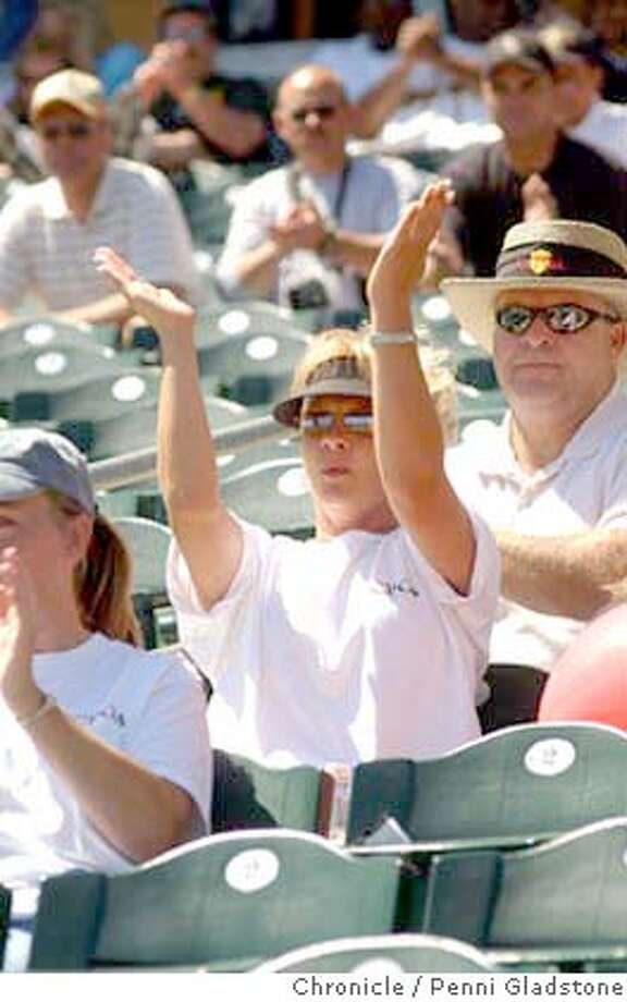 Cheering a speaker is Kim Bacchi a correctional officer at Folsom State Prison. state prison guards union hold rally to combat recent negative publicity about them.  6/13/04 in Sacramento.  Penni Gladstone / The Chronicle Photo: Penni Gladstone