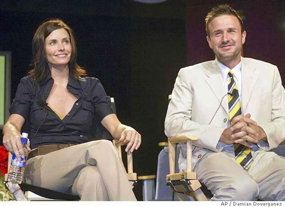 """Courteney Cox and husband David Arquette take questions from the media Tuesday, July 8, 2003, during the presentation of Women's Entertainment new show """"Mix it Up,"""" at a hotel in the Hollywood area of Los Angeles. Cox and Arquette are creators and executive producers of this new home-themed series, which is inspired by their own decorating dilemmas. (AP Photo/Damian Dovarganes) Photo: DAMIAN DOVARGANES"""