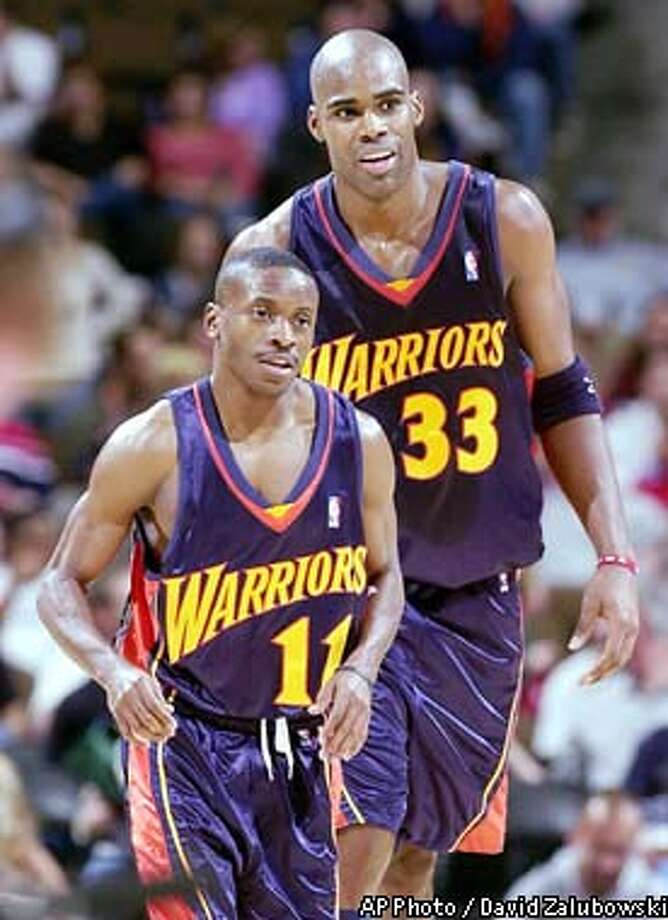 Golden State Warriors guard Earl Boykins, front, is congratulated by forward Antawn Jamison during a time out after Boykins helped to lead the Warriors back from a 20-point deficit during the third quarter of the Warriors' 92-82 victory over the Denver Nuggets in Denver on Friday, Nov. 29, 2002. Boykins scored 20 points off the bench to lead the Warriors' rally. (AP Photo/David Zalubowski) Photo: DAVID ZALUBOWSKI