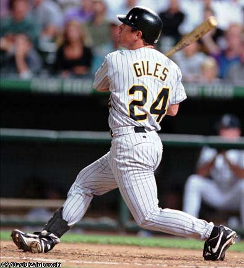 Pittsburgh Pirates' Brian Giles connects for a solo home run on a pitch from Colorado Rockies starting pitcher John Thomson to lead off the second ining in Denver's Coors Field Tuesday, Aug. 31, 1999. (AP Photo/David Zalubowski) Photo: DAVID ZALUBOWSKI