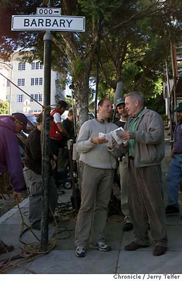 "TALES31A-C-28JUL00-DD-JLT Director Pierre Gang (tan sweater) author Armistead Maupin chat while filming location shots for the third serial based on Maupin's ""Tales of the City"" in SF.  Macondry Lane - Russian Hill  CHRONICLE STAFF PHOTO BY JERRY TELFER Photo: JERRY TELFER"