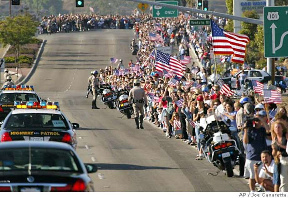 The California Highway Patrol clears the road in Camarillo, Calif, to make room for the hearse carrying 's casket Friday, June 11, 2004 en route to the Presidential Library where he will be buried.(AP Photo/Joe Cavaretta,Pool) Photo: JOE CAVARETTA