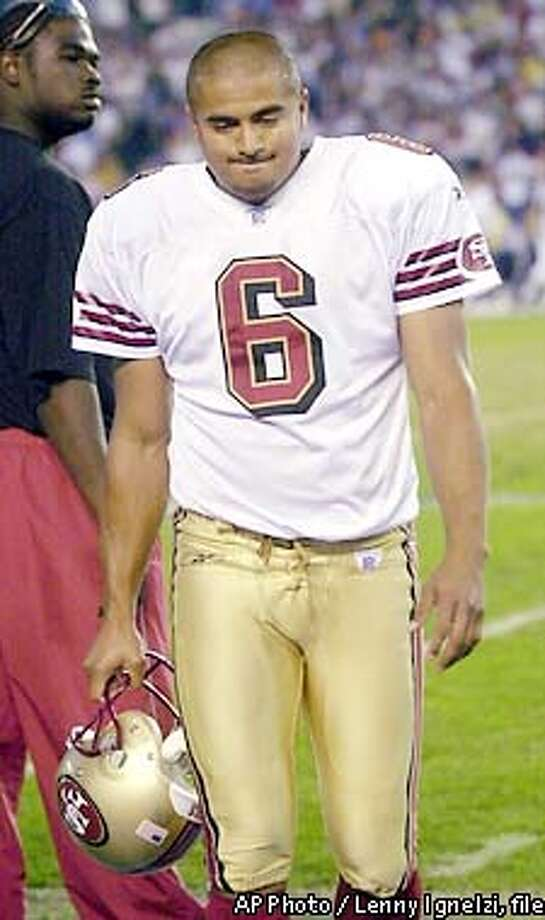 ** FILE ** San Francisco 49ers kicker Jose Cortez walks on the sideline after missing a 41 yard field goal in overtime in the 49ers 20-17 loss to the San Diego Chargers Sunday Nov. 17, 2002 in San Diego. Cortez calmly leaned on his locker at the San Francisco 49ers' training complex on Monday, Nov. 18, 2002, fully aware he might be kicked out at any moment. A day after Cortez's 41-yard overtime field goal attempt went well wide of the uprights in San Diego, the 49ers made no decision on the fate of their star-crossed kicker, who missed a potential game-winning kick for the second time in three weeks. (AP Photo/Lenny Ignelzi,file) Photo: LENNY IGNELZI