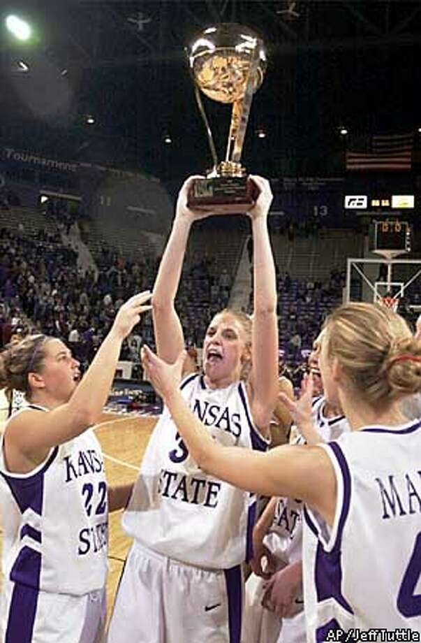 Kansas State's Megan Mahoney holds up the championship trophy as she celebrates with teammates Chelsea Domenico, left, and Brie Madden, right, after they defeated Penn State 88-66, to win the Preseason Women's National Invitation Tournament Sunday, Nov. 24, 2002, in Manhattan, Kan. (AP Photo/The Wichita Eagle, Jeff Tuttle) Photo: JEFF TUTTLE