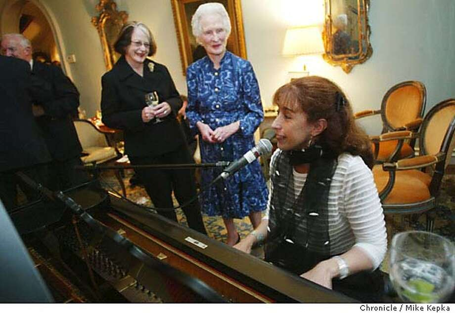 modernlife130077_mk.jpg Katie Cardinal and Betty Sutro gather around the piano as Leslie Harlib plays a few standards.  For the 5 year, local piano players and several guests come to Betty Sutro's house in San Francisco for a piano party starring her Steinway grand piano.  5/27/04 in San Francisco. Mike Kepka / The Chronicle Ran on: 06-13-2004  Katie Cardinal and Betty Sutro enjoy Leslie Harlib's playing at a piano party in Sutro's Pacific Heights home. Photo: Mike Kepka