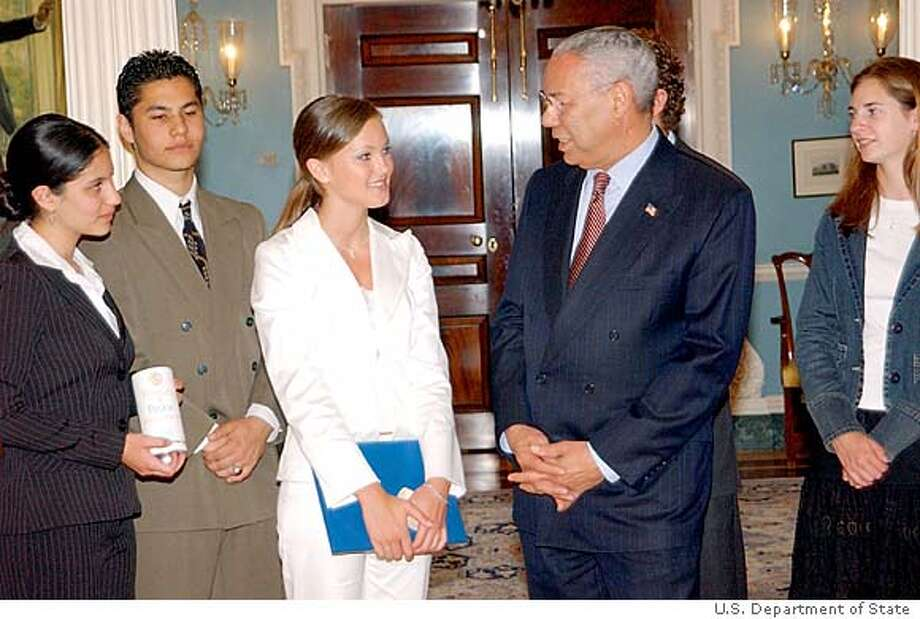 Sec. of State Colin Powell chats with Kyleigh Kuhn. Others in the picture: Rebecca Maher(left), Amir Maher, Tucker Kuhn (hidden), Kelly McGaw credit: U.S. Department of State