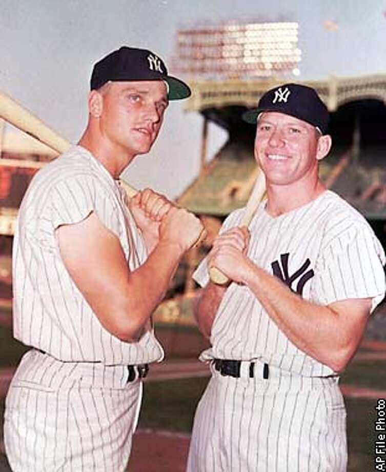 FILE--Mickey Mantle, right, and Roger Maris are shown in this 1961 file photo. Ruth and Gehrig. Mantle and Maris. And now, Frank Thomas and Albert Belle, set to take their place among the most dynamic duos ever. (AP Photo/file) ALSO RAN: 07/02/98.