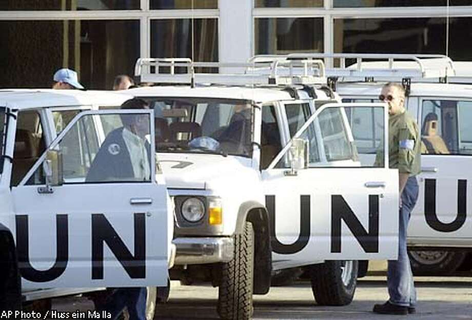U.N. weapons inspectors prepare their cars at the mission inside the U.N. headquarter in Baghdad, Iraq, on Wednesday Nov. 27, 2002. Weapons inspectors began work in Iraq on Wednesday for the first time in four years. (AP Photo/Hussein Malla) Photo: HUSSEIN MALLA