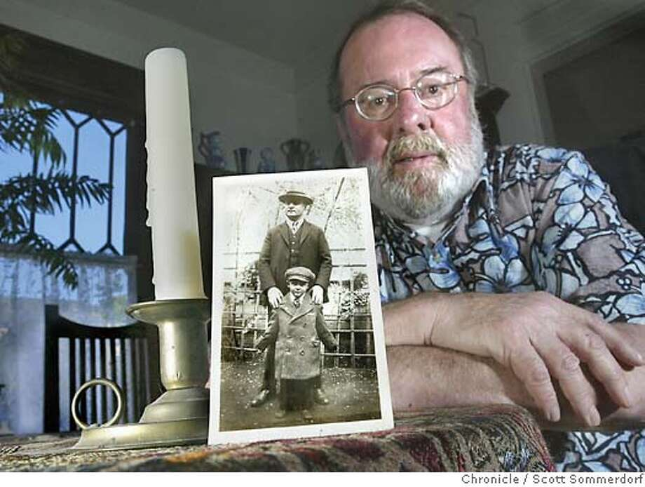 """Robert Kaiser's family was very frgula growing up in San Francisco during the Great Depression. Here is poses with a photo taken in 1932 of his father and his older brother Frank. Robert would later be given the woolen coat his brother is wearingin the photo. The candle holder to the left is still in use in his home today and was used by his parents.  =-=-=-=-=-=-= He will provide one of several voices for an economics story on consumer debt. He talks about his mom burning moldy bread in the stove for heat because """"it was a sin to waste food"""" and his dad, a waiter, getting new collars to put on old shirts.  San Francisco on 6/1/04 by SCOTT SOMMERDORF / The Chronicle Photo: SCOTT SOMMERDORF"""