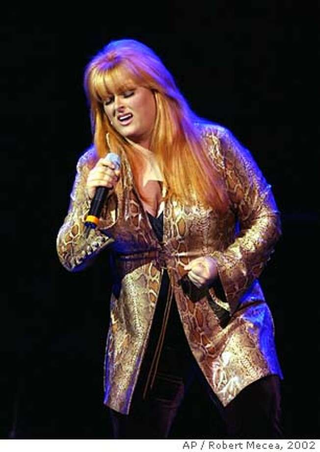 BECK24a-C-13APR02-DD-AP  Wynonna Judd performs during the Rainforest Foundation benefit concert at Carnegie Hall in New York, Saturday, April 13, 2002. (AP Photo/Robert Mecea) Photo: ROBERT MECEA