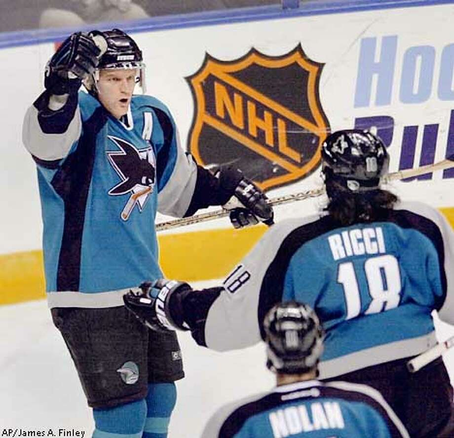 San Jose Sharks' Vincent Damphousse, left, celebrates with teammates Mike Ricci (18) and Owen Nolan after Damphousse scored on a power play during the first period against the St. Louis Blues, Monday, Nov. 25, 2002, in St. Louis. (AP Photo/James A. Finley) Photo: JAMES A. FINLEY