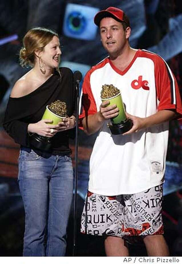"""Adam Sandler and Drew Barrymore accept their Best On-screen Team awards for their roles in """"50 First Dates"""" during taping of the on Saturday, June 5, 2004, in Culver City, Calif. The show will air on Thursday, June 10. (AP Photo/Chris Pizzello) Photo: CHRIS PIZZELLO"""