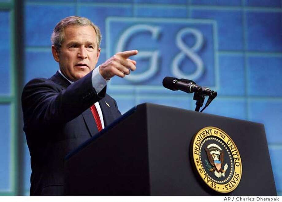 President Bush takes a question at a press conference after the G-8 Summit in Savannah, Ga., Thursday, June 10, 2004. (AP Photo/Charles Dharapak) Photo: CHARLES DHARAPAK