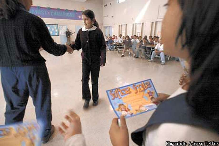 "Verde Elementary School 4th grade student Jazmin Madrigal (cq) gets a ""Super Star"" award for perfect attendance and academic performance during a monthly motivational ceremony at the struggling North Richmond school.  2000 Giaramita Street - North Richmond, CA  CHRONICLE STAFF PHOTO BY JERRY TELFER Photo: JERRY TELFER"