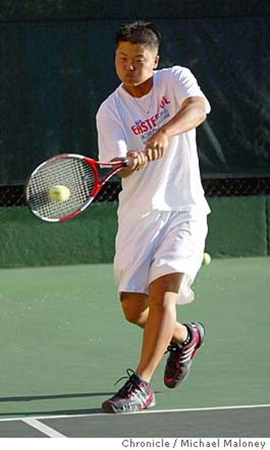 Jay Wong with a double-handed forearm during practice in Los Gatos.  Srchbishop Mitty sophomore Jay Wong just won the Central Coast Section boys singles tennis title. He's one of the top-ranked junior players in the area and is preparing for a summer of USTA tournaments starting this weekend in Portola Valley.  Photo by Michael Maloney / San Francisco Chronicle Photo: Michael Maloney