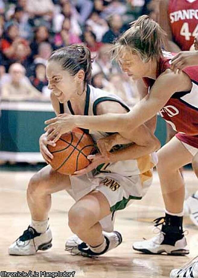 STANWOMEN1-C-24NOV02-SP-LM  Stanford women's basketball team beat USF Dons at USF.  USF's #42 Carey sauer grabss the ball as Stanford's Krista Rappahahn reaches in. Chronicle Photo by Liz Mangelsdorf. Photo: Liz Mangelsdorf