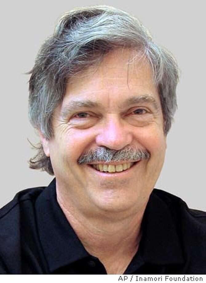 American computer scientist Alan Kay, president of Viewpoints Research Institute in Glendale, Calif., smiles in this undated photo distributed by Japan's Inamori Foundation Friday, June 11, 2004. Kay, 64, won this year's advanced technology award of Kyoto Prize, a Japanese award for top achievements in arts and sciences, for creating the concept of personal computing and contributing to its realization, the foundation, the prize presenter, announced in Kyoto Friday. The prize will be awarded in the western Japanese city of Kyoto in November. (AP Photo/ Inamori Foundation ) Ran on: 06-12-2004  Computer scientist Alan Kay picks up his third major award this year.