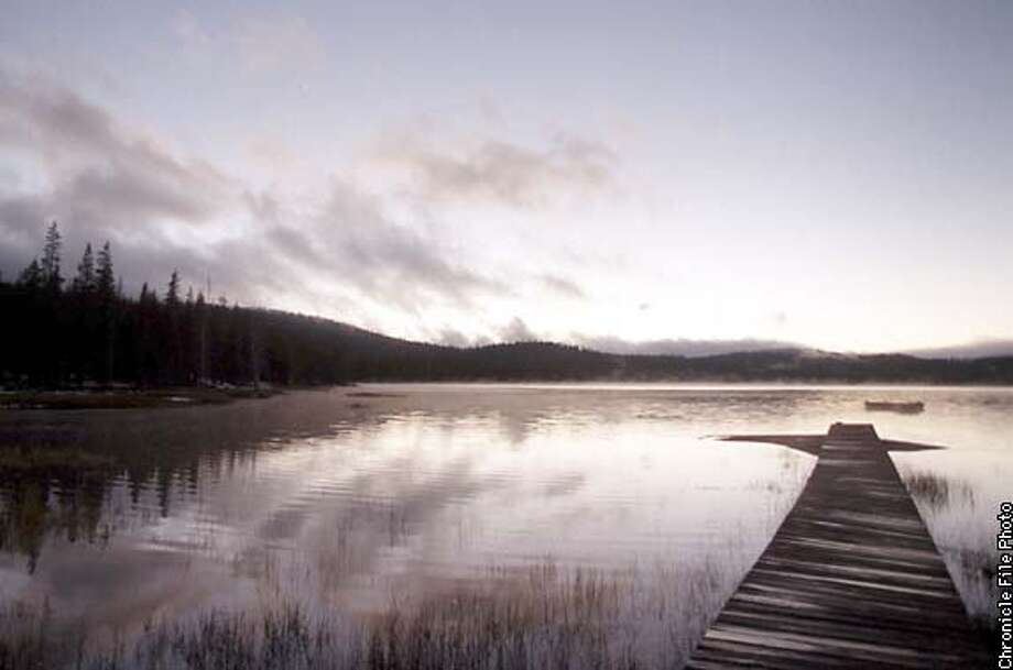 A small boat dock jets out into the waters of Medicine Lake. This was shot 10/25/98. Brad Garrison Photo: BRAD GARRISON