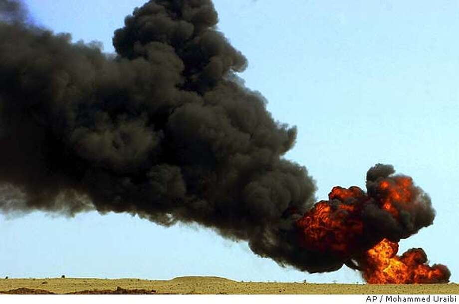 An oil pipeline burns in the desert near Beiji, Iraq about 250 kilometers (155 miles) north of Baghdad Wednesday June 9, 2004. Saboteurs blew up the pipeline Wednesday, forcing a 10 percent cut in output for the national electricity grid, Iraqi officials said. The attack appeared part of an insurgent campaign against infrastructure to shake confidence in the new government. (AP Photo/Mohammed Uraibi) Photo: MOHAMMED URAIBI