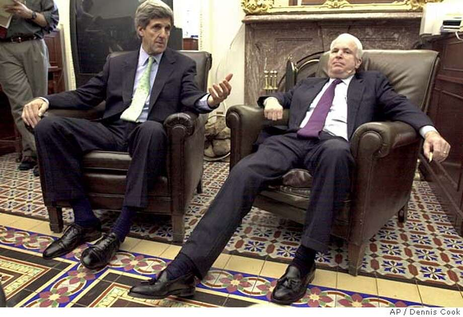 **FILE**Sen. John Kerry, D-Mass., left, and Sen. John McCain, R-Ariz., meet with reporters on Capitol Hill in this March 13, 2002 file photo, to discuss automobile mileage standards being bebated on the Senate floor. Republican Sen. John McCain has personally rejected John Kerry's overtures to join the Democratic presidential ticket and forge a bipartisan alliance against President George W. Bush, The Associated Press has learned. (AP Photo/Dennis Cook) Ran on: 06-12-2004  Sens. John Kerry (left) and John McCain discuss auto mileage standards during deliberations in 2002. Photo: DENNIS COOK