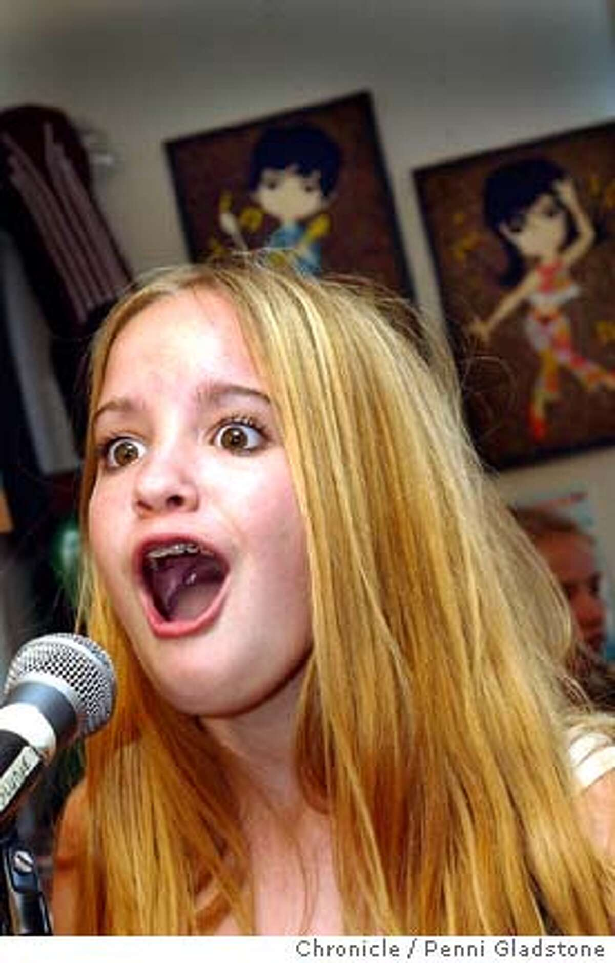 Clare Wlodarczyk age 13 of Curiously Strong sings her heart out during practice. SF's own school of rock, the Rock Academy run by Professor Sludge, aka Eric Lencher. on 6/1/04 in San Francisco, CA. must credit photo by Penni Gladstone/