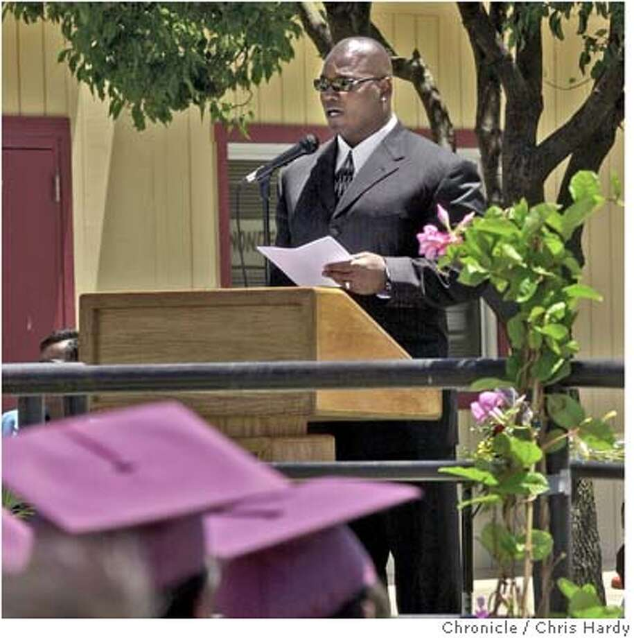 "49ers Bryant Young is guest speaker at 8th grade graduation of 49ers Academy in East Palo Alto. Young and his wife, Kristin, have adopted the class when they were in seventh grade. The academy is for ""at-risk"" kids who might otherwise have dropped out of school. at East Palo Alto,CA on 6/10/04  San Francisco Chronicle/Chris Hardy Photo: Chris Hardy"
