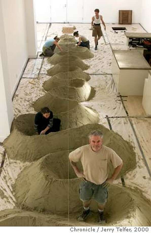"Noted British sculptor Andy Goldsworthy (foreground) is creating a serpentine sculpture of sand for a show titled ""River"" at the Haines Gallery.  49 Geary Street  CHRONICLE STAFF PHOTO BY JERRY TELFER Photo: JERRY TELFER"