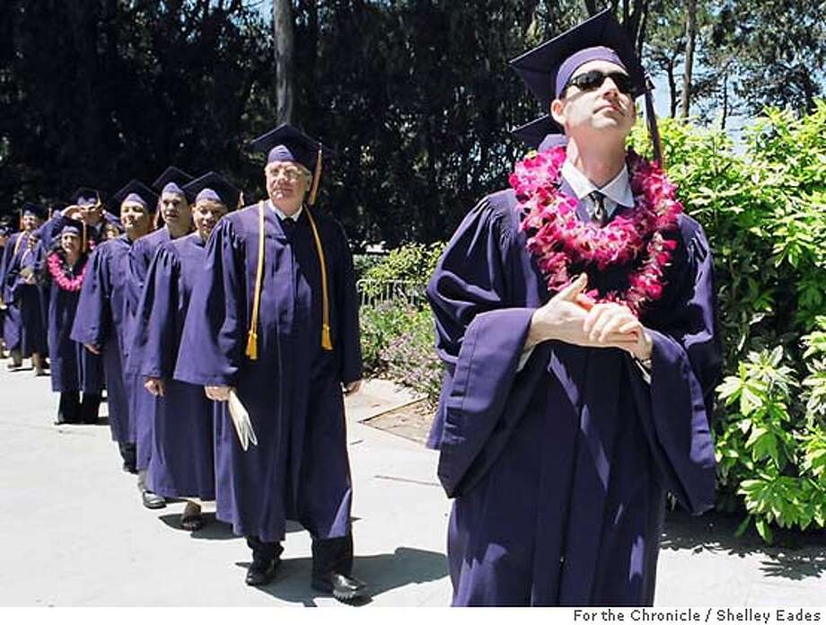 DELANCEY05  PHOTO BY SHELLEY EADES/FOR THE CHRONICLE MAY 29, 2004  Right to left, Todd Terway, John Pavao, Anita Jackson, Robert Bernardo and Carl Hall begin their walk during commencement ceremonies at San Francisco State University on Saturday. They are five of the nine Delancey Street Foundation residents who are the first-ever graduates of the unique program and have earned bachelor's degrees in Urban Studies from SFSU this year.